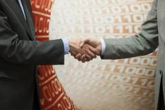2 persons shaking hands in agreement
